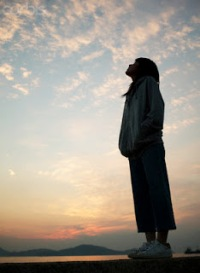 Woman Looking at the Sky --- Image by © Bloomimage/Corbis